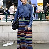 A denim work shirt put a classic spin on her brightly striped maxi skirt.