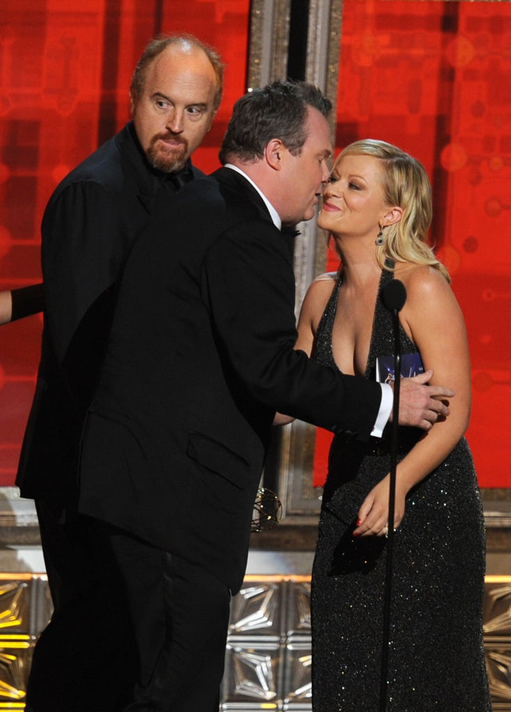 Amy Poehler was greeted by Louis C.K. and Eric Stonestreet onstage at the Emmys.
