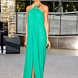 Erin Heatherton glowed in this summery turquoise halter-style dress by Michael Kors. She paired gold accents with the look to keep with that bronzed goddess vibe.
