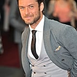 Jude Law wore a vest under his jacket.