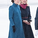 Earlier that day, she wrapped up in her blue Catherine Walker coat.