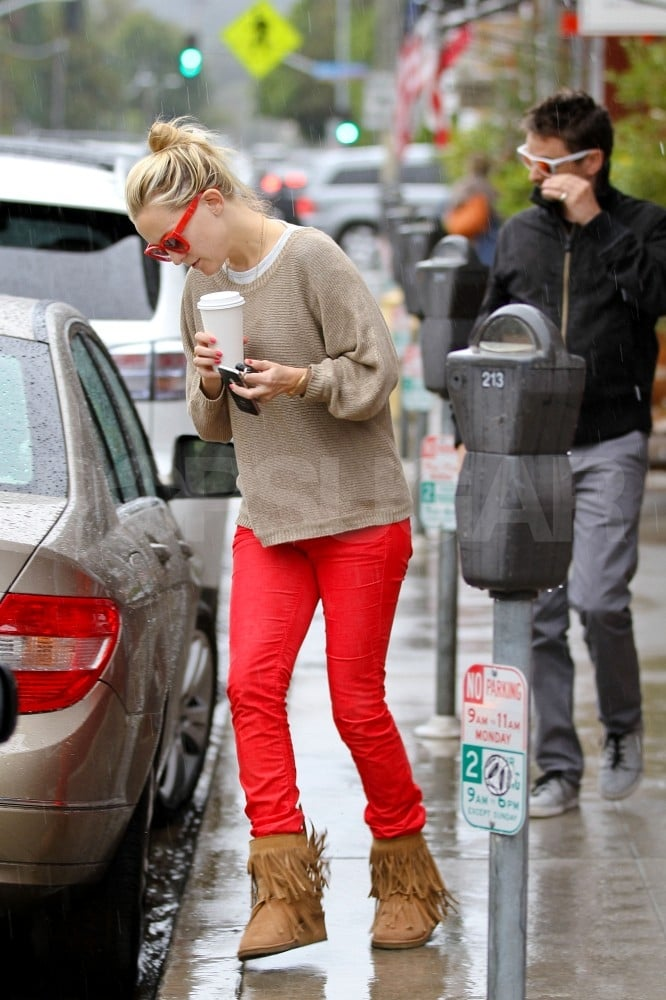 Kate Hudson wore her red jeans yesterday when she and fiancé Matt Bellamy stopped for lunch and coffee at LA's Brentwood Country Mart. They sat down for lunch inside and were spotted holding hands over their table after a waiter had cleared their plates. Despite the rain, both Kate and Matt rocked sunglasses as they ran out to their Prius.  The jet-setting couple is back in California following a couple trips to London over the last few months. England-born Matt and his band Muse have apparently been working on their next album there. Work has brought Kate home to the US, though, to shoot The Reluctant Fundamentalist in NYC. She headed west in time to host her annual Halloween party, which brought out a J. Lo-clad Nicole Richie and Gwen Stefani as Cinderella. Kate and a couple of her close friends reportedly dressed up like Playboy Bunnies.
