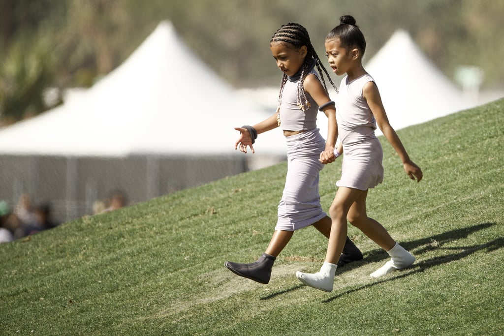 "North West solidified herself as a future trendsetter in February when she covered Women's Wear Daily with pigtails and neon liner, and the 5-year-old isn't slowing down. The Kardashian offspring arrived at Coachella with her family to watch her dad, Kanye West, perform his ""Sunday Service"" in braids featuring small troll dolls at the ends. West's mom, Kim Kardashian, posted a video of her daughter's new hair to her Instagram Story to show off the accessory and the small pops of pink in West's hair.  Check out the troll doll accessories ahead."