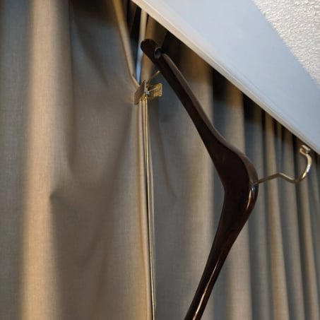 This Hotel Hanger Hack Will Keep Your Room Dark For Sleep