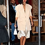 This outfit is anything but boring. In 2019, Rihanna paired a silk skirt with an oversize blazer and went without a shirt, bringing this all-beige look to the next level. She accessorized with Le Vain necklaces and a Fendi bag.