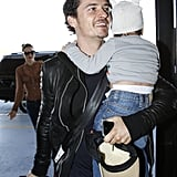 Orlando Bloom carried baby Flynn as they walked into the airport.