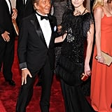 Valentino and Natalia Vodianova in his design