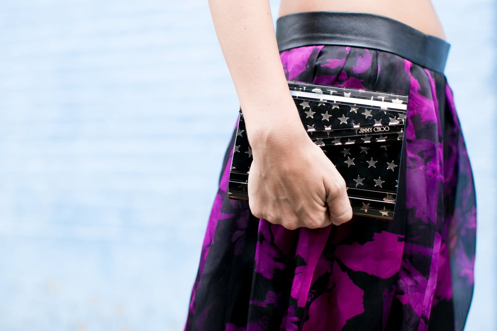 A star-studded Jimmy Choo clutch paired perfectly with a bold camo print.