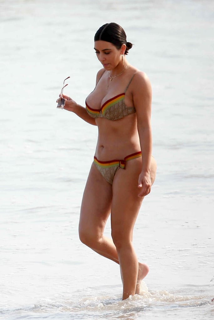 Kim strutted her stuff on the beach in Mexico wearing a Gucci-print bikini in April 2017.