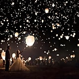 Light up the night sky with a lantern release. Check out more great stories from Bridal Guide:  50 Wedding Ideas You've Never Seen Before 50 Ideas for a Classic Fairy Tale Wedding 25+ of the Most Unique Wedding Themes We've Ever Seen 21 Hacks Every Budget-Conscious Couple Should Know 50 Ways to Share Your Love Story at the Wedding