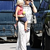 Gwen Stefani adjusted her shades as she carried Zuma Rossdale.