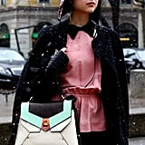 A colorblocked satchel topped off this feminine ensemble.
