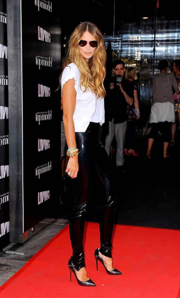 Rocking leather again. This time Elle dressed down her leather pants via a white tee and aviator sunglasses, then dressed them back up with pointy metallic pumps.       Pumps by Diane von Furstenberg
