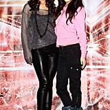 Cheryl kept things casual in wet-look trousers and a metallic knit, but not as casual as her X Factor mini me Cher Lloyd.