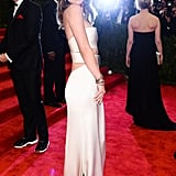 Calvin Klein Ivory Matte Satin Bandeau Dress ($10,000), worn by Olivia Wilde Source: Joe Schildhorn/BFAnyc.com