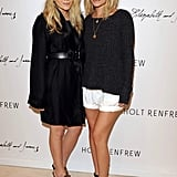 Twinning combo: During an August 2009 Elizabeth and James presentation in Toronto, the girls paired their Summer basics with embellished platform sandals.  Mary-Kate slipped on a belted black coatdress and jeweled Miu Miu sandals. Ashley paired a ribbed sweater with cuffed white shorts and t-strap Prada sandals.