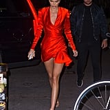 We could barely tear our eyes away from Kendall when she stepped out in this flirty wrap dress by Nicolas Jebran. Between the silky material, bright blood-orange hue, and short hemline, she certainly commanded attention on the streets of NYC.