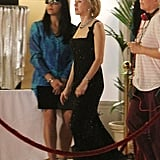 Naomi Watts wore a long gown on set.