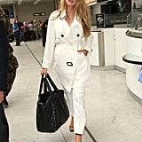 Arrive looking polished and professional — just like Blake Lively — by rocking tailored white pants with a trench of the same color.