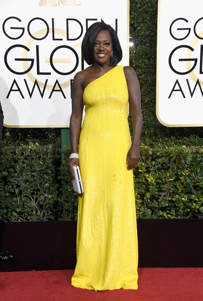 Viola Davis in a Michael Kors Collection one-shoulder dress, Stuart Weitzman shoes, and more than 90 carats of Harry Winston diamonds in 2017.