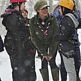 Kate Middleton braved the wind and snow to spend time with a group of young scouts at a British campsite in March.