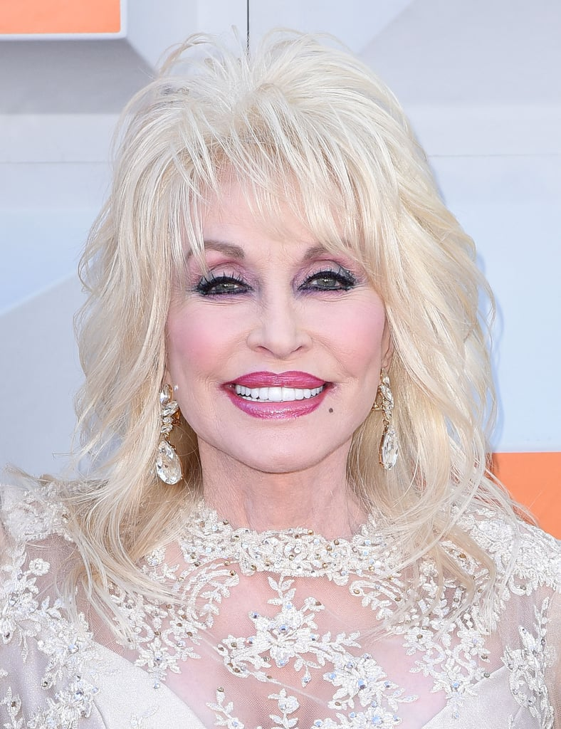 "Dolly Parton's makeup looks have inspired fans for years, but one of her travel beauty tips might have dermatologists doing a double take. In a recent interview with the New York Times the country singer revealed that she sleeps in her makeup, along with the surprising reason why. ""You never know if you're going to wreck the bus, you never know if you're going to be somewhere in a hotel and there's going to be a fire,"" she said. ""So I leave my makeup on at night and clean my face in the morning.""   Dermatologists will tell you that sleeping with your makeup on might cause clogged pores and dry skin. Brittney Danberry, PA-C at Schweiger Dermatology Group in NYC, previously told POPSUGAR that you should wash your makeup off if you're planning on sleeping for more than 15 to 20 minutes.  Read the entire interview here, and see the country music star in some of her most memorable makeup looks ahead."
