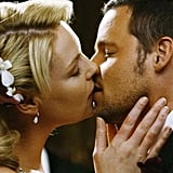 Izzie and Alex share a tender, long-awaited kiss at the altar.