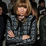 Donning a polished printed suit and a bevy of colorful necklaces, Anna Wintour was ready to critique the Creatures of the Wind collection.