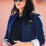 Meghan in a Navy Blazer With Striped Cuffs