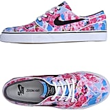 Stand out from the crowd in these vibrant pink and blue Nike Sneakers ($99).