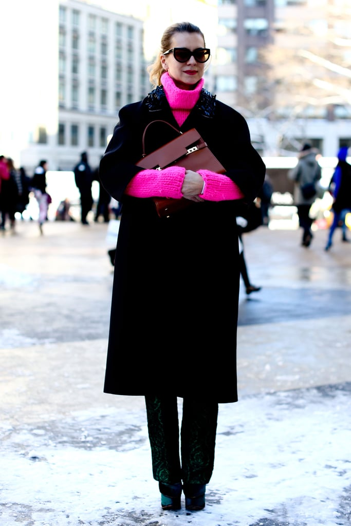 Natalie Joos added a jolt of high-wattage hot pink to black outerwear.