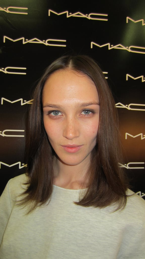 "Mac Cosmetics' James Malloy talks us through the look. . . ""It's definitely a morning after the night before kind of makeup, but not in a bad girl way. She just forgot to take her eyeliner and mascara off and she's woken up and just swiped it away from underneath her eyes, so she's just got this really nice, lived-in, top liner. We are using Mac Pro Cream Color Base in Black and Mac Cosmetics Black Eye Kohl in Smoulder, and we're just kind of smudging that into the lashes so it does its own thing. It's not about being too perfect, that's a bit boring, I think."""