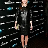 Olivia put her spin on a little black leather dress with jewels at the collar and a pair of ankle-strap heels.