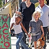Angelina Jolie took her daughters, Zahara and Shiloh Jolie-Pitt, skipping and shopping in LA in July 2011.
