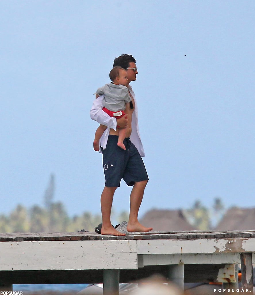 Orlando Bloom held onto baby Flynn on a dock in Bora Bora.