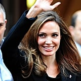 Angelina Jolie waving to fans.