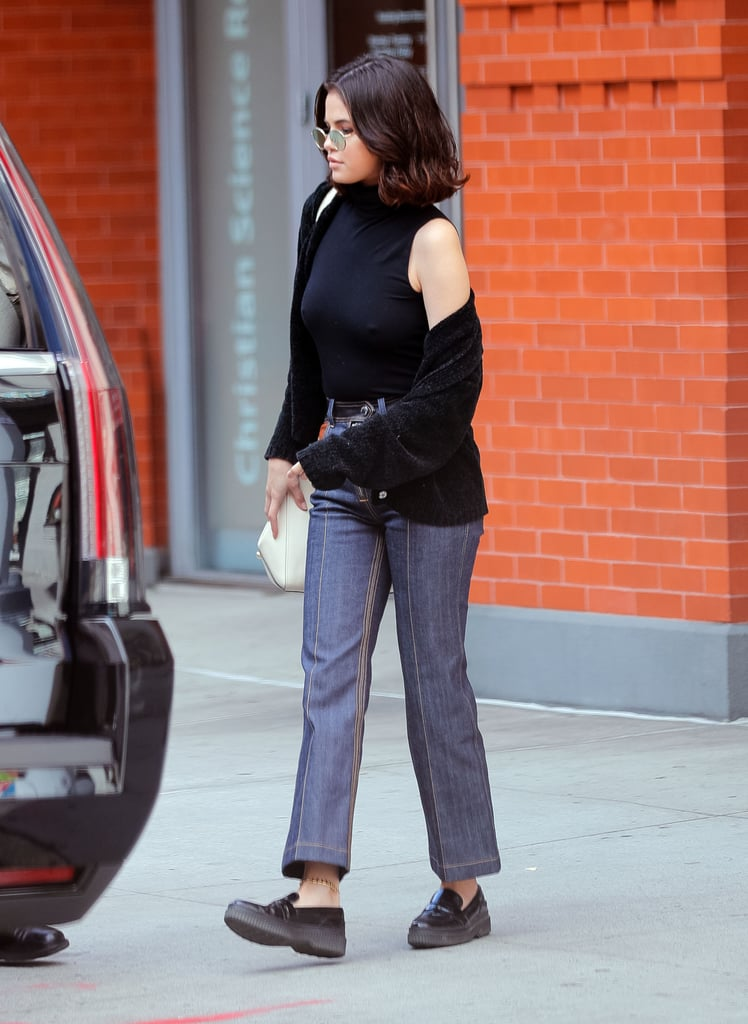 759cf022d9b Selena styled a pair of patchwork Louis Vuitton jeans with a ...