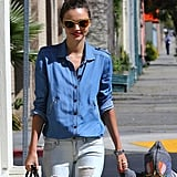 Miranda Kerr's gold glittery Miu Miu sunglasses — score the red or bronze version here ($395) — added much-needed sparkle to her denim ensemble in LA.