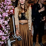 Harley Viera Newton attended the party in a maxi skirt, crop top, and cardi.