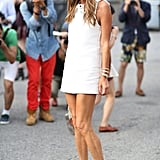 Anna Dello Russo caused a photo frenzy (per usual) with her stem-baring LWD. Source: Greg Kessler