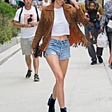 Every off-duty model has to master the white tee and denim shorts look. Kendall Jenner did that with a fringed suede jacket and velvet boots.