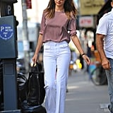 Miranda Kerr stepped out in white pants and a polka-dot shirt in NYC.