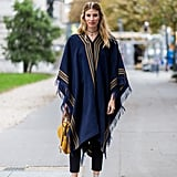 If you're going for a look that's sporty-meets-boho, style a fringed poncho over slim jeans and complete with your high tops and a pendant choker.