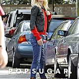 Gwyneth Paltrow wore a black jacket over a red sweater for an outing in London.