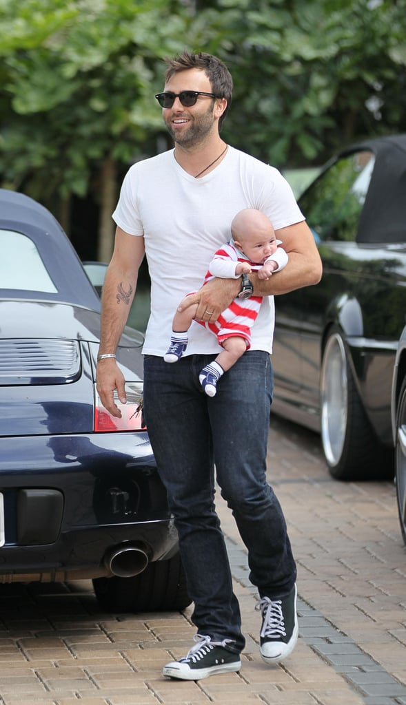 Jamie Mazur carried Noah to the market in LA.