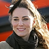 A feathered piece topped Kate's look for an event in 2011.