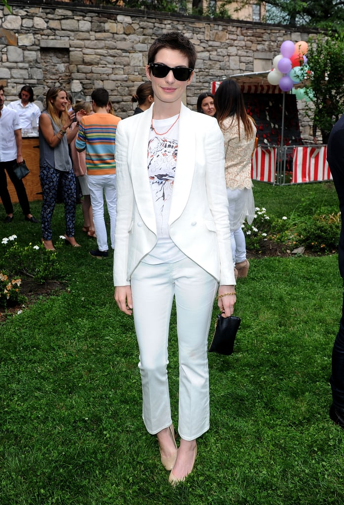 Anne Hathaway looked sophisticated in a white pant suit at Stella McCartney's Spring presentation in NYC.