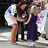 During a visit to London's Keech Hospice Care in August 2016, Kate was greeted by a little girl with flowers.