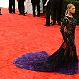 Beyoncé Knowles made her way into the Met Gala in a feathered Givenchy number.