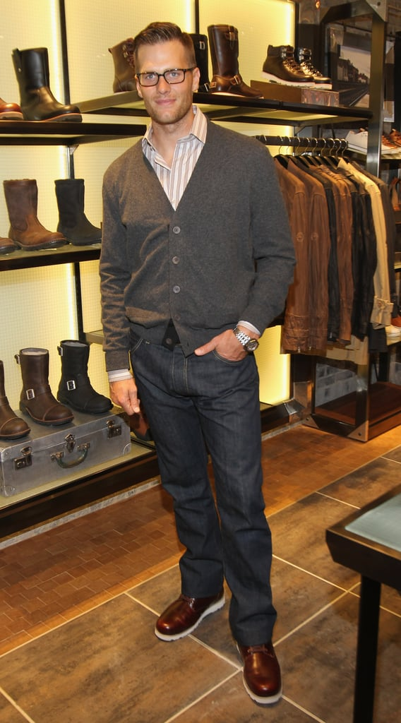 Tom Brady combed his hair and left his shirt and cardigan casually buttoned for the grand opening of the Ugg For Men store in NYC on Tuesday evening. As the face of the brand, Tom was looking every bit the model as he posed for the cameras even without wife Gisele Bundchen on his arm. Gisele is currently in Rio for a series of events to honor World Environment Day, a cause very close to her heart. While in her native Brazil, she made an appearance yesterday where Gisele showed a bit of stomach amid rumors that she is expecting baby number two with Tom. The couple have yet to comment on the reports, but doting dad Tom was once again showing his fatherly side at his annual Best Buddies charity event outside Boston last weekend.